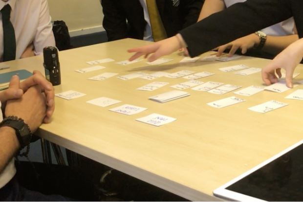 Students playing the card game during a user research session