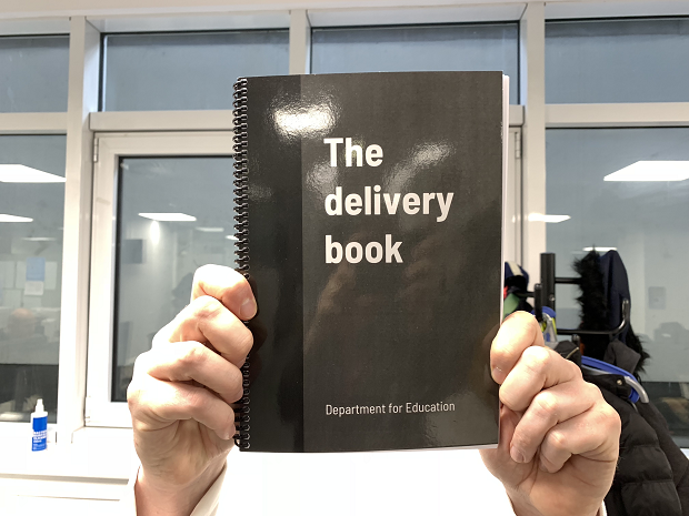 The delivery book being held up