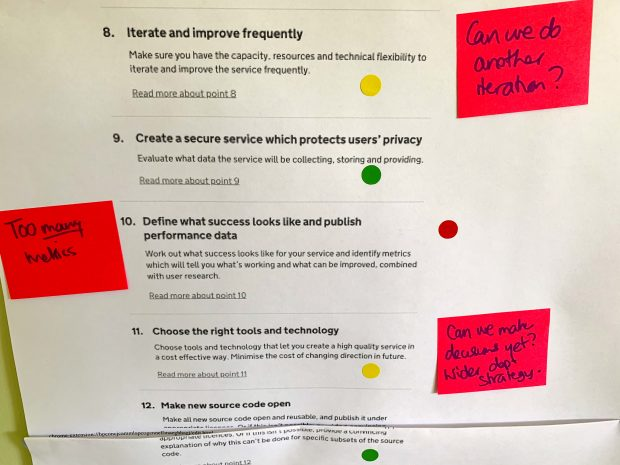 Service assessment criteria list with coloured dots on