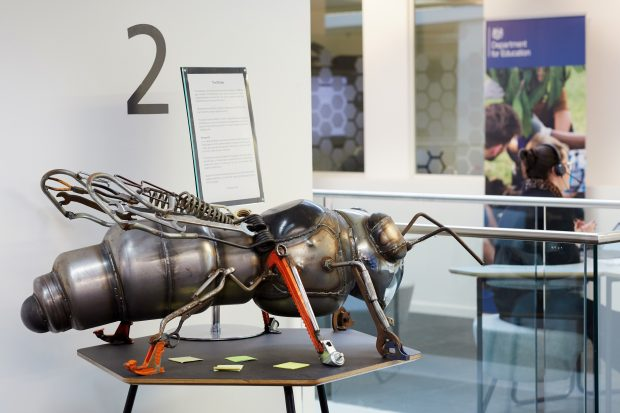 A photo of a big metal bee structure in our Manchester office.