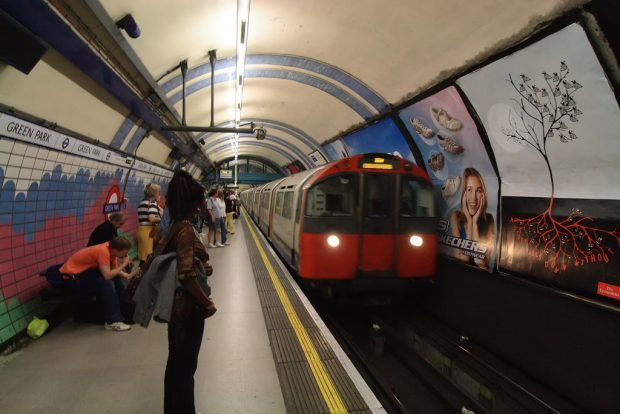 Photo of woman standing on Green Park tube station platform