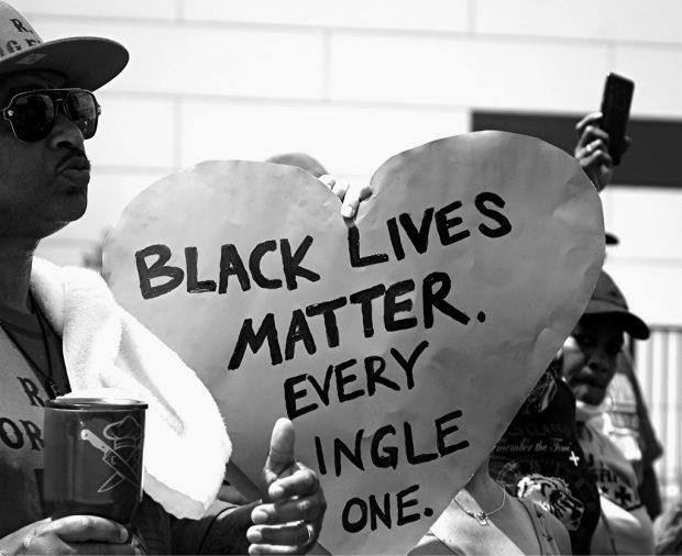 Protester with a Black Lives Matter ballon