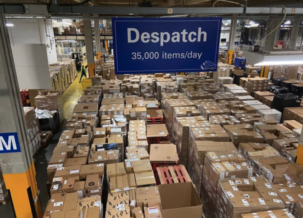 a warehouse full of boxed up computers and laptops